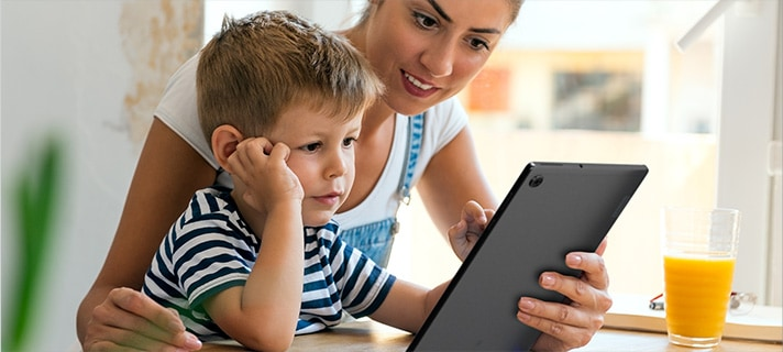 Mother with child using tablet