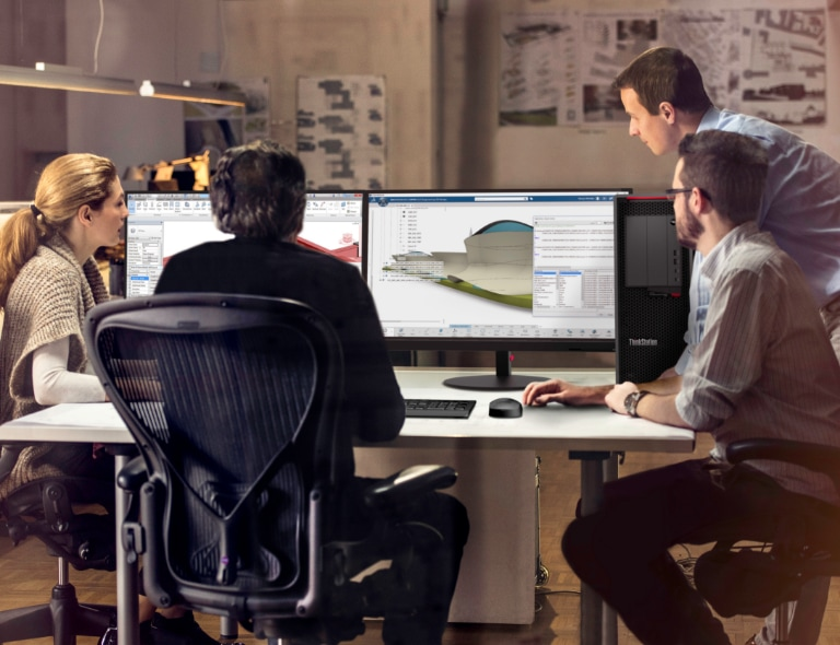 Two white men hovering over a desk where someone uses the Lenovo ThinkStation P620 tower workstation with dual monitors showing CAD rendering.