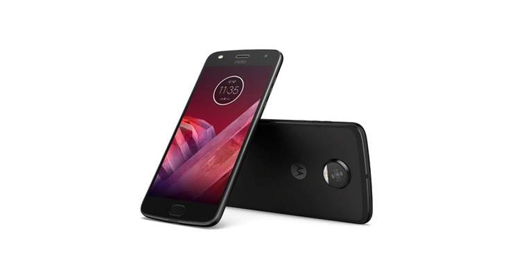 Two moto z2 play smartphones next to JBL SoundBoost 2 moto mod