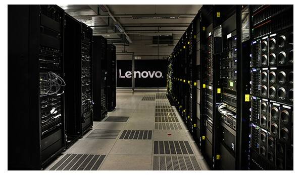 Hallway lined with servers and Lenovo logo in background