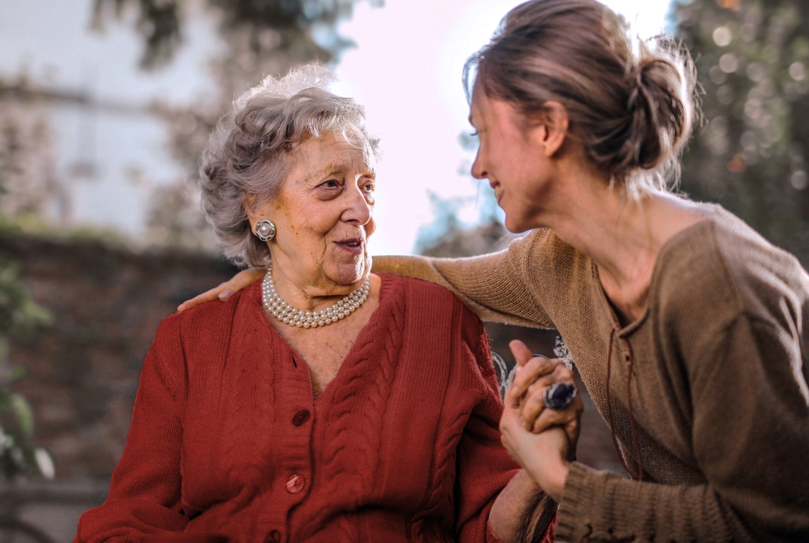 A young woman and an elderly woman talking