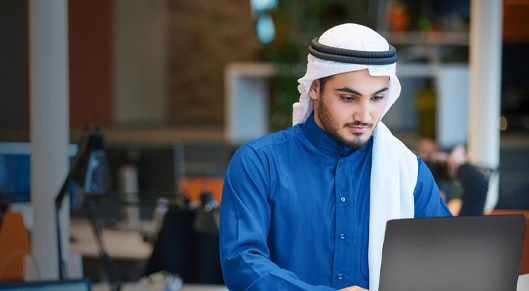 Man on laptop in an office