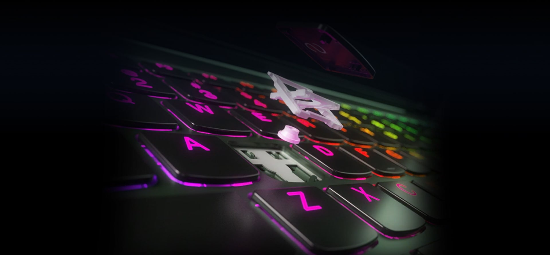 Up close view of Lenovo keyboard and track button with colorful backlighting