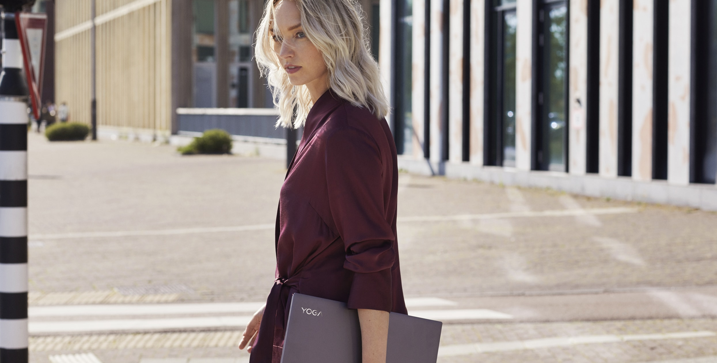 Yoga C940 Lifestyle Image Holding Laptop